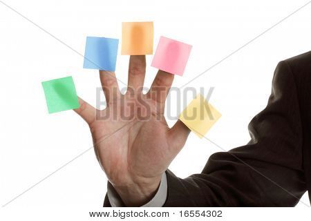 Businessman holds up five blank multi colored stickies, one on each finger ready for text messages