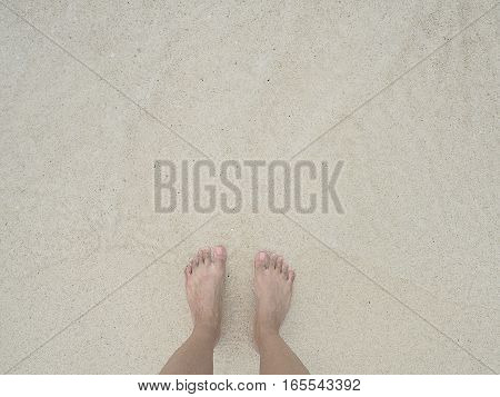 top feet on beach. relax summer in sea.