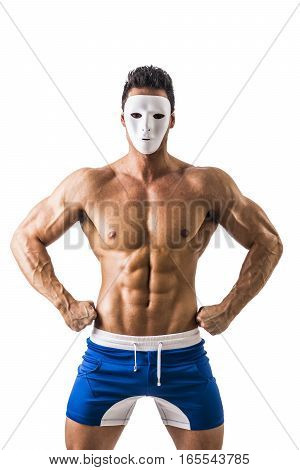 Shirtless muscle man with creepy, scary mask on tilted head, isolated on white background