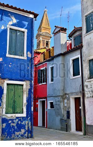 Courtyard between colorful houses on the famous island Burano Venice. Venice and the Venetian lagoon are on the UNESCO World Heritage List