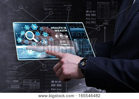 Business, Technology, Internet And Network Concept. Young Business Man Writing Word: Health Is Wealt