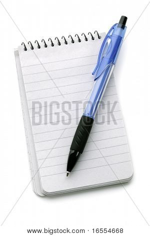 Ballpoint pen resting on a blank note pad isolated on white