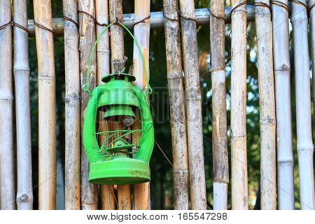 Colorful Asia Vintage Kerosene Oil Lantern Hang On Bamboo Wall For Decorate In Garden.
