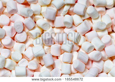 marshmallows top view , sweet background or texture of mini marshmallows