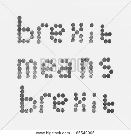 Brexit means brexit written with one pound coins