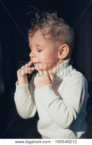 emotional child having fun on a dark background