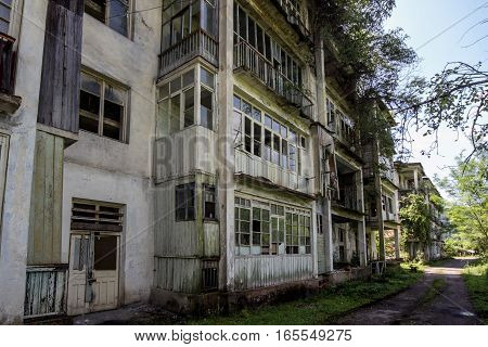 Abandoned mining ghost-town Polyana, Abkhazia. Destroyed empty houses, remnant of The Georgian-Abkhazian war