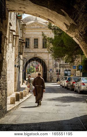 JERUSALEM ISRAEL - OCTOBER 5: One of the streets of the Old City with arch Armenian Quarter in Jerusalem Israel on October 5 2016