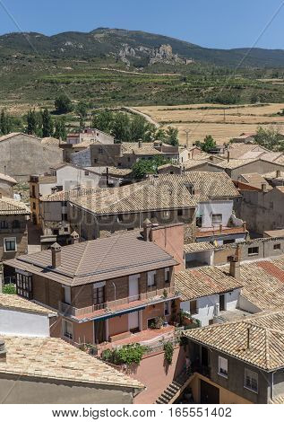 Aereal views of the village of Loarre Aragon Huesca Spain, the main square, the inn and the town hall, old houses, narrow streets, on the right in the background the Loarre Castle