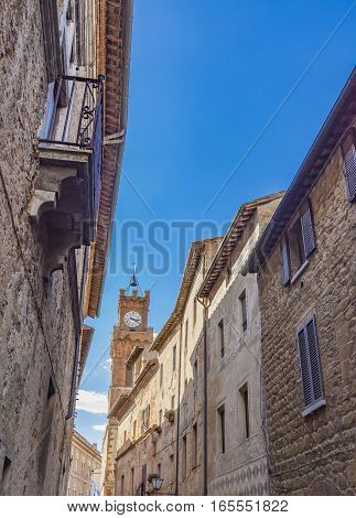 View at narrow street in Pienza, Italy