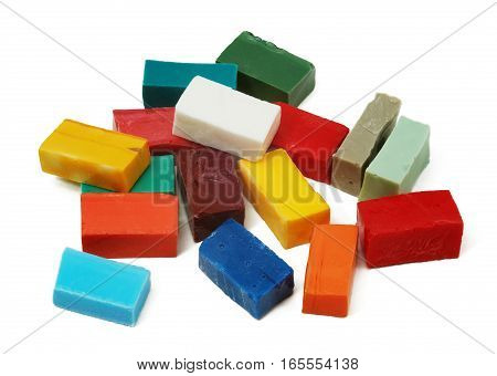 Pile of smalt tiles of different colors on white background
