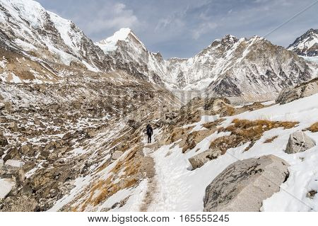 Hikers Walking On The Trail Along Khumbu Glacier Leading To Everest Base Camp In Nepal.