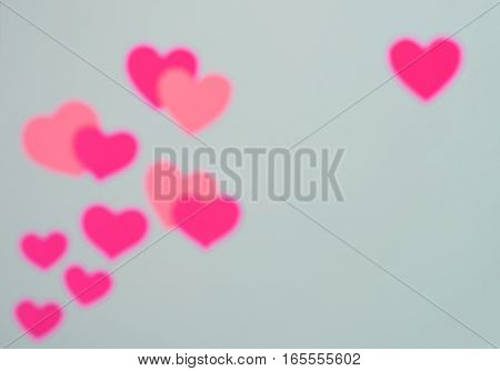 Blurred hearts on paper background Valentine's Day concept. Holiday card with hearts.Abstract backround made of hearts symbols. Background for valentine day. Valentine background. Valentine background abstract