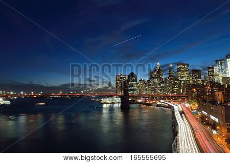 Night view of Lower Manhattan with Brooklyn Bridge and FDR Drive.