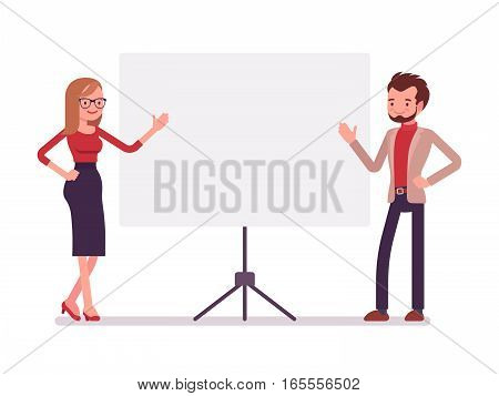 Young confident business man and woman near the standing presentation display board, pointing with hands, effective teamwork, presenting a topic, full length, copy space