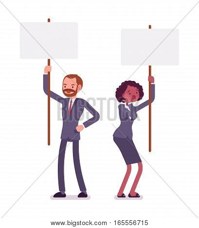 Frustrated businessman and businesswoman holding picket signs, demonstrating demands and disagreement, protest against management and policy, full length, copy space