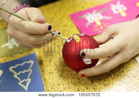 Girl Painting Christmas Toy