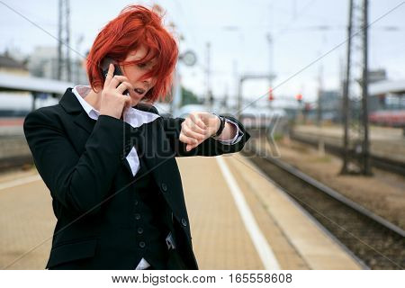 a businesswoman is waiting for her late train