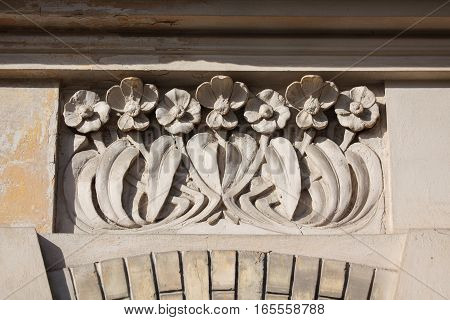 Ornate wall with floral pattern. Detail of building in Zverynas district in Vilnius Lithuania.