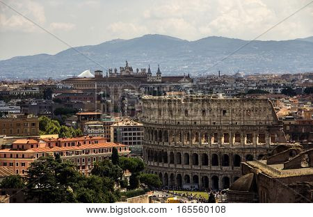 Rome overview with monument and several streets, roofs, domes, Coliseum, Imperial Forum, Rome, Italy