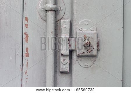 old window Lock on vintage wooden door, painted covering wood, metal and screws