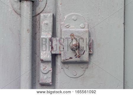 detail old window Lock on vintage wooden door, painted covering wood, metal and screws