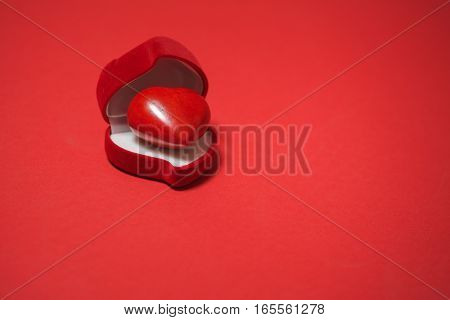 red heart in gift box on red background. Valentine's day