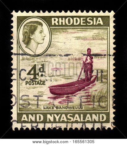 Rhodesia and Nyasaland- CIRCA 1959: A stamp printed in United Kingdom shows Queen Elizabeth II and Lake Bangweulu, circa 1959