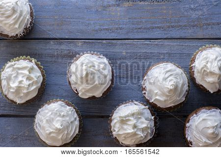 Fresh baked cupcakes on a blue wood rustic table