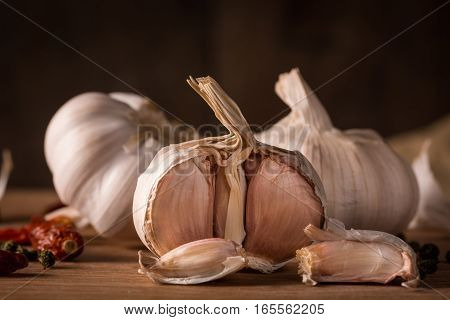 head of garlic on a wooden table