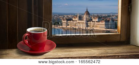 Cup of coffee with a view of the parliament building in Budapest
