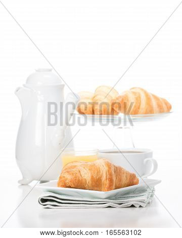 fresh buttery croissants served with coffee and juice.