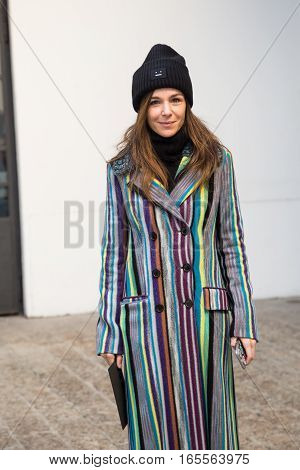 MILAN ITALY - JANUARY 15: Fashionable woman poses outside Damir Doma fashion show building during Milan Men's Fashion Week on JANUARY 15 2017 in Milan.