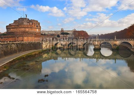 view of the Castel Sant'Angelo (Mausoleum of Hadrian) and statues of angel figure on the Sant'Angelo bridge over the Tiber river, Rome, Italy