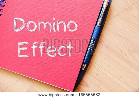 Domino effect text concept write on notebook