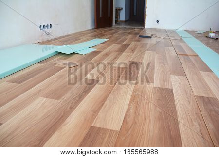 Laminate flooring interior. Installing wooden laminate flooring.
