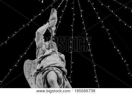 Angel blowing in horn Christmas street decorations black and white photography.