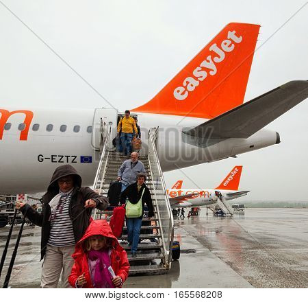 Paris France - April 28 2013: Passengers descend from the airplane of EasyJet to enter the bus. Easyjet is the second largest low-cost airline of Europe after Ryanair.