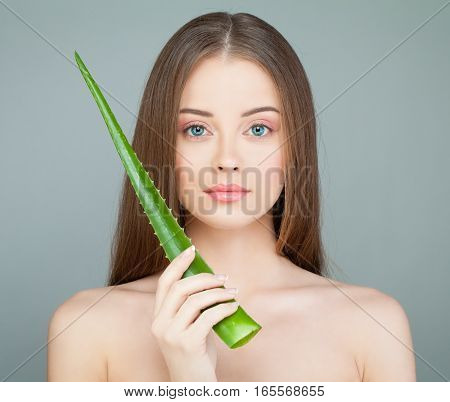 Spa Model Woman with Cute Face Fresh Skin and Green Aloe Leaf
