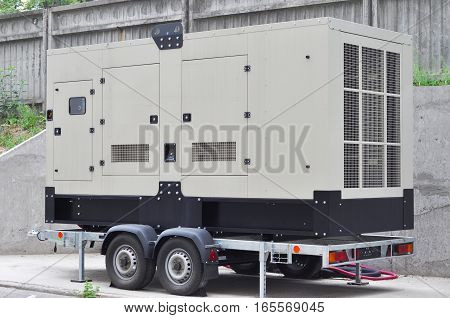 Commercial backup generator. A standby generator is a back-up electrical system that operates automatically. A standby power system may include a standby generator batteries and other apparatus.