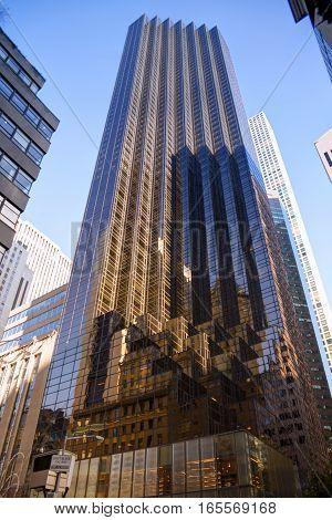 Tall skyscraper in New York city blue sky in background.