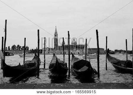 Row of four gondola's in Venice Italy.