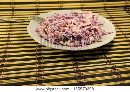 Coleslaw salad of red cabbage with onion and mayonnaise