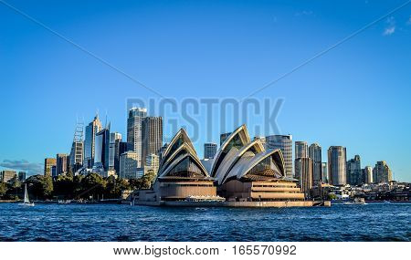 SYDNEY, NSW / AUSTRALIA - JULY 5, 2014: View from ferry, City CBD and Opera House  on July 5, 2014. in Sydney, Australia.