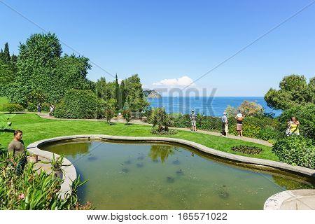 PARTENIT CRIMEA RUSSIA - JUNE 10.2016: The pond on the shore of the Black sea in the Park of Paradise. Partenit Crimea Russia