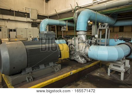 several water pumps with large electric motors