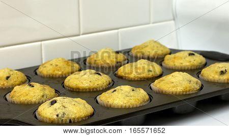 Homemade banana chocolate chip muffins in pan.