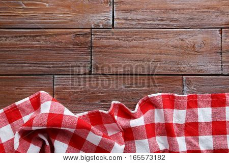 Red Napkin On A Brown Wooden Table