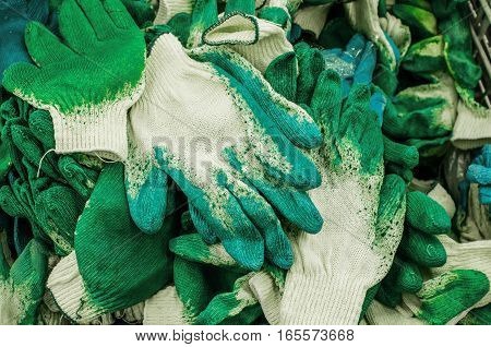 Construction Gloves with rubberized fingers in the basket in a supermarket store
