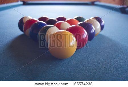 Billiard balls triangle on the pool table.